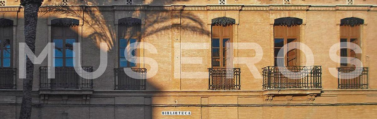 logotip museroa sobre la façana de les escoles velles ara biblioteca municipal